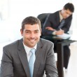 Happy businessman in the foreground during a meeting — Stock Photo