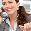 Stock Photo: Smiling businesswoman talking on the phone