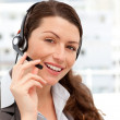Beautiful businesswoman with headphones and smiling at the camer — Stock Photo