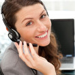 Stock Photo: Pretty female representative on phone with earpiece on
