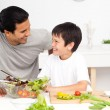 Adorable father and son looking at each other in the kitchen — Stock Photo #10839287