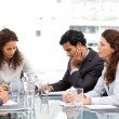 Multi ethnic business team working together during a meeting — Stockfoto