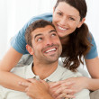 Portrait of a pretty woman hugging her husband - Stockfoto
