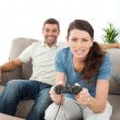 Concentrated woman playing video game with her boyfriend — Stock Photo #10839654