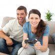 Portrait of a woman playing video game with her boyfriend - 