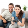 Portrait of a woman playing video game with her boyfriend - Stock Photo