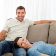 Portrait of a cheerful couple resting together on the sofa — Stock Photo #10839705