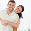 Portrait of a happy couple standing in the living room — Stock Photo #10839707