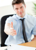 Self-assured businessman reaching his hand to the camera — Stock Photo