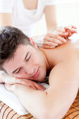 Charming young man in an acupuncture therapy in a Spa center — Stock Photo