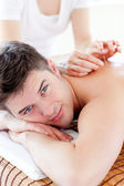 Happy young man in an acupuncture therapy — Stock Photo