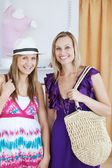 Charming female friends smiling at the camera — Stock Photo