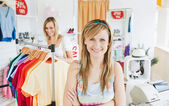 Delighted young woman smiling at the camera doing shopping with — Stock Photo