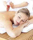 Attractive caucasian woman receiving a tapping massage — Stok fotoğraf