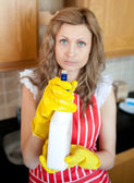 Beautiful blond woman holding cleansing agent into the camera — Stock Photo