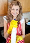 Cheerful blond woman holding cleansing agent into the camera — Stock Photo
