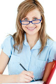 Ambitious businesswoman taking notes smiling at the camera — Stock Photo
