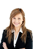 Assertive businesswoman with folded arms smiling at the camera — Stock Photo