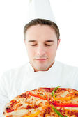 Young male cook smell at pizza with closed eyes — Stock Photo