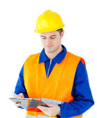 Charming young worker writing on a clipboard — Stock Photo