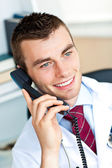 Happy male doctor talking on phone — Stock Photo