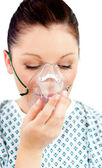 Diseased female patient wearing a oxygen mask — Stock Photo
