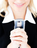 Close-up of a caucasian businesswoman sending a text — Stockfoto