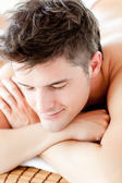 Portrait of a smiling man lying on a massage table — Stock Photo