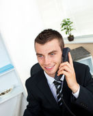Sophisticated young businessman talking on phone — Stock Photo