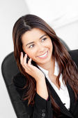 Animated asian businesswoman talking on phone — 图库照片