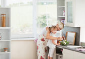 Jolly girl preparing a salad with her mother — Stock Photo