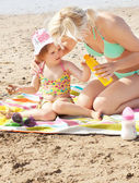 Attentive mother at the beach with her daughter — Stock Photo