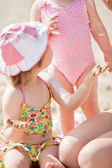 Close-up of a cute little girl at the beach — Stock Photo