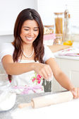 Lively asian woman baking in the kitchen — Stock Photo