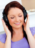 Blissful woman listen to music — Stock Photo