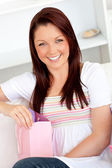 Blissful woman getting a present — Stock Photo