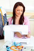 Merry woman sewing at home — Stock Photo