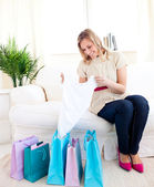 Bright woman with shopping bags at home — Stock Photo
