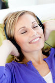 Relaxed woman listen to music with closed eyes — Foto de Stock