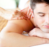 Close-up of an attractive man having a back massage — Stock Photo