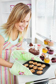 Charming woman baking in the kitchen — Stock Photo