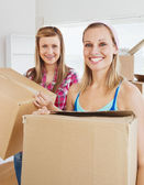 Charming friends holding boxes — Stock Photo