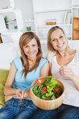 Animated women eating a salad — Stock Photo