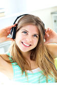 Lively young woman listen to music — Стоковое фото