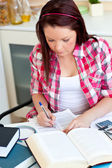 Concentrated student doing her homework at home — Stock Photo