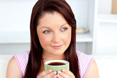 Caucasian woman holding a cup of coffee at home — Stock Photo
