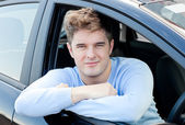 Positive young man sitting in his car — Foto Stock
