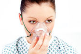 Female patient with an oxygen mask — Stock Photo