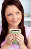 Positive woman holding a cup of coffee — Stock Photo