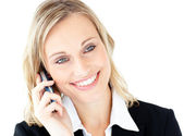 Portrait of a radiant businesswoman talking on phone — Stock Photo